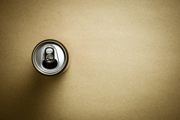 Top view of a aluminum cans on brown paper background.