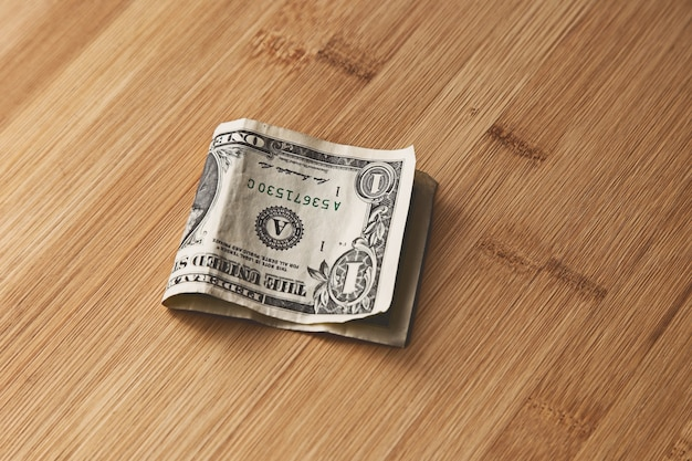 Top view of an american dollar bill on a wooden surface