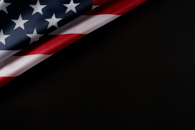 Top view of american flag on dark background