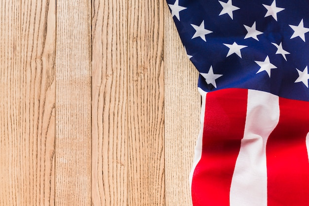 Top view of american flag on wooden surface with copy space