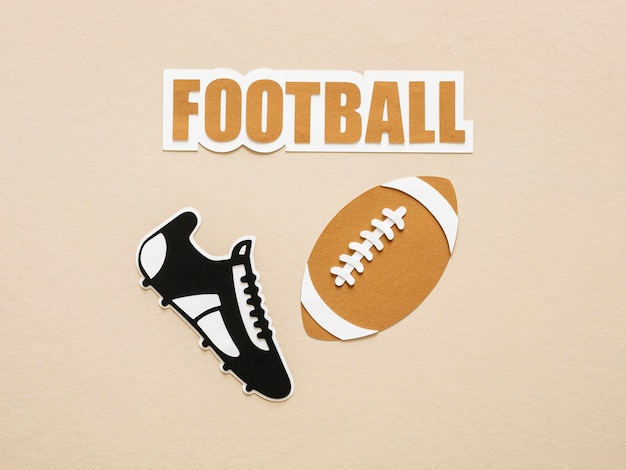 Top view of american football and sneaker