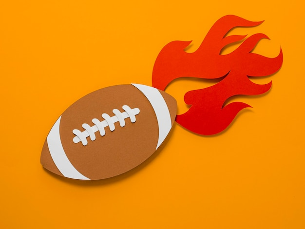 Top view of american football with flame