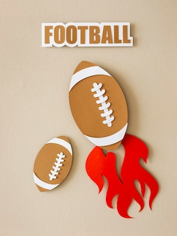 Top view of american footballs with flame