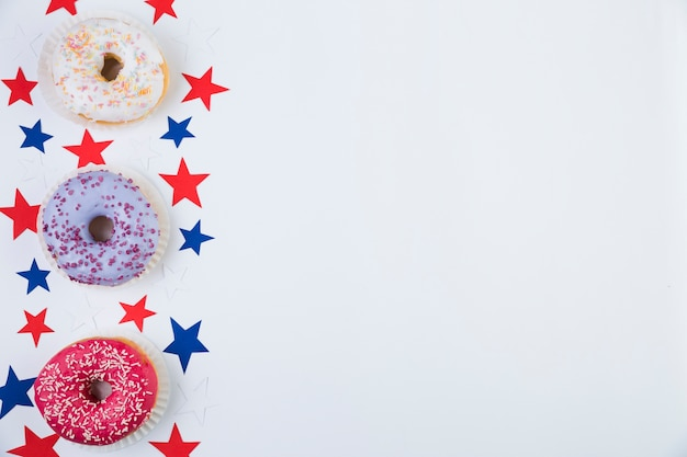 Top view of american stars and donuts