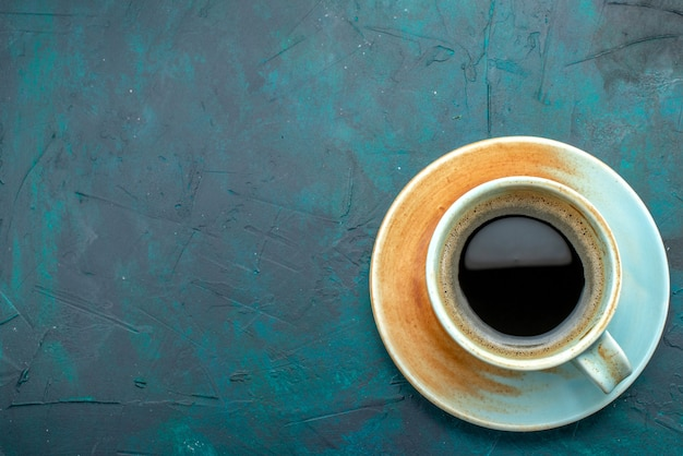 Top view of americano with shadow effect on saucer and white cup