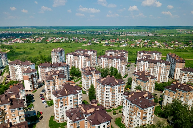 Top view of apartment or office tall buildings, parked cars, urban city landscape. drone aerial photography.