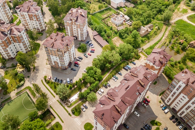 Top view of apartment or office tall buildings, parked cars, urban city landscape.