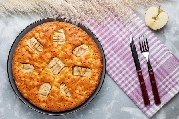 Top view apple pie inside pan on the light desk sugar cake biscuit pie sweet bake