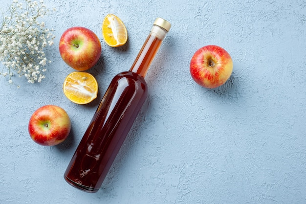 Top view apple vinegar in bottle on white background juice fruit color photo fresh drink sour food