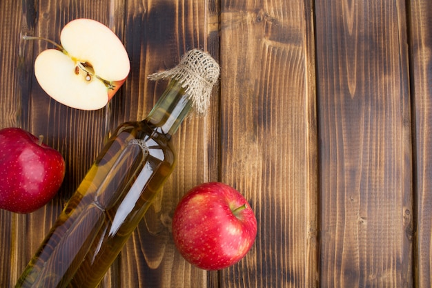 Top view of apple vinegar cider in glass bottle