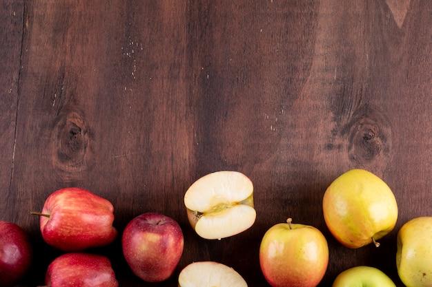 茶色の木製水平にコピースペースを持つトップビューりんご