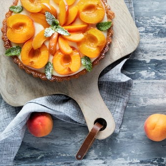 Top view of apricot tart with mint leaf