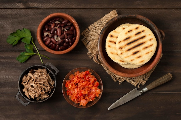 Top view arepas on wooden table