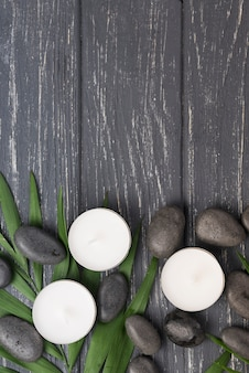 Top view aromatherapy spa candles and stones