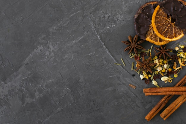 Top view aromatic herbs with cinnamon sticks