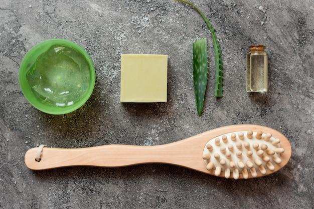 Top view arrangement of aloe vera cosmetics and brush