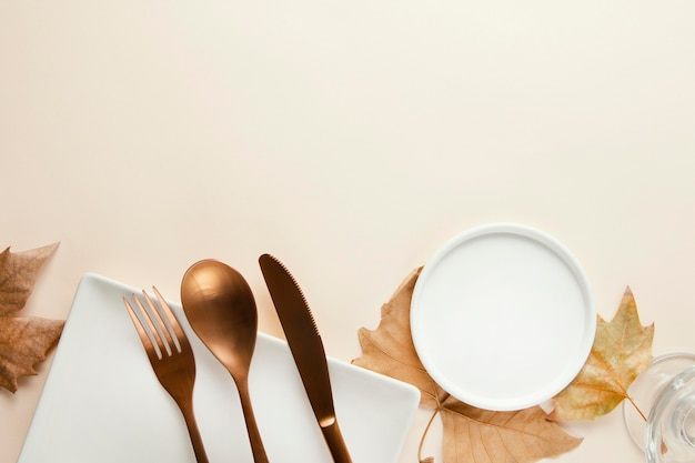 Top view arrangement of beautiful tableware with copy space