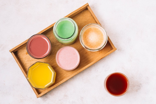 Top view arrangement of colorful smoothies