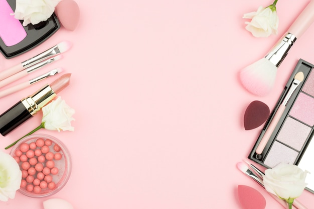 Top view arrangement of cosmetics with copy space