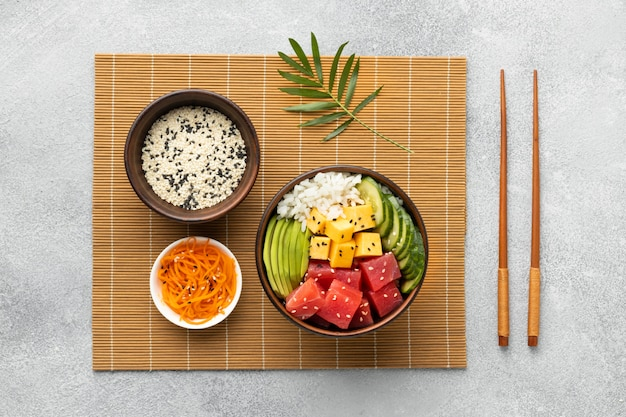 Top view arrangement of delicious poke bowl