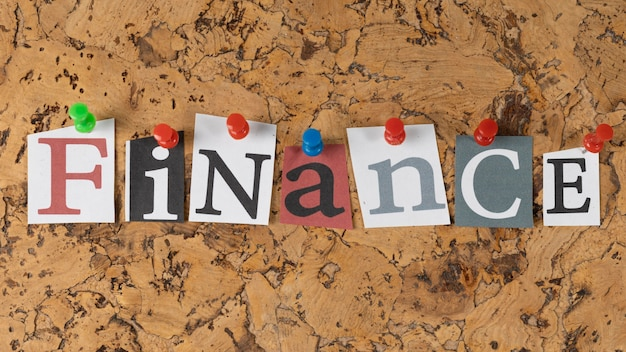 Top view arrangement of finance word on sticky notes