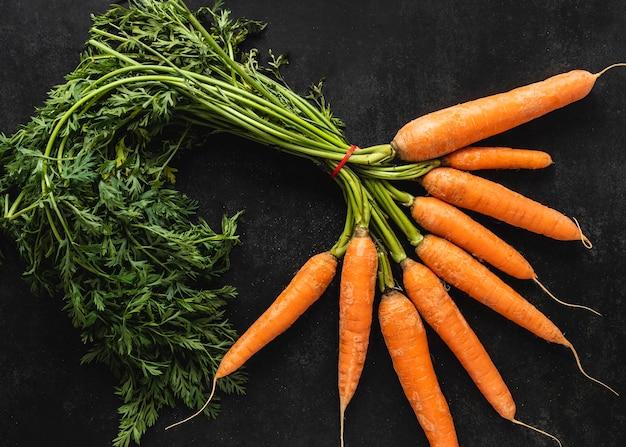 Top view arrangement of fresh carrots