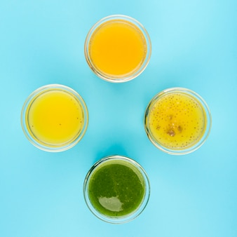 Top view arrangement of glasses with natural juice