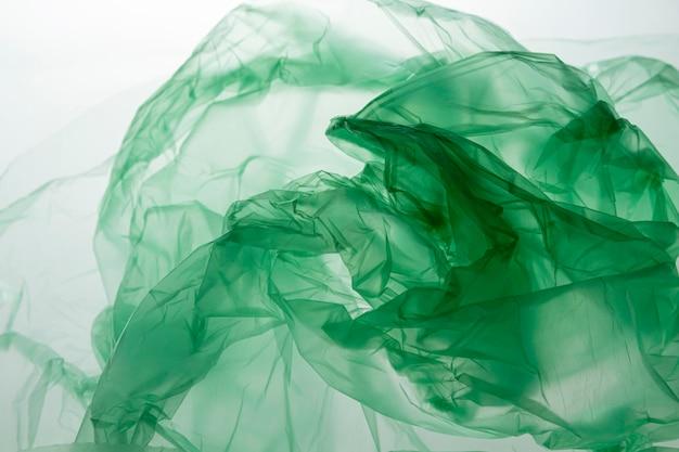 Top view arrangement of green plastic bags