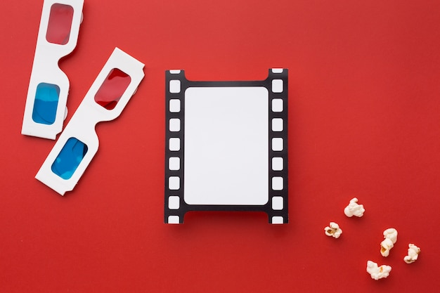 Top view arrangement of movie elements on red background