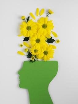 Композиция из концепции оптимизма с цветами сверху