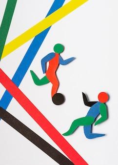 Расположение фигур олимпийских игр в бумажном стиле