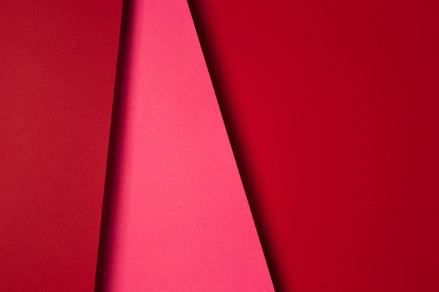 Top view arrangement of red paper sheets