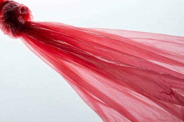 Top view arrangement of red plastic bags