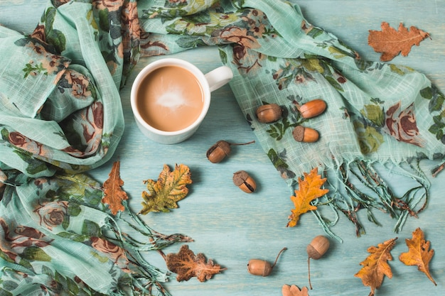 Top view arrangement with autumn leaves and coffee