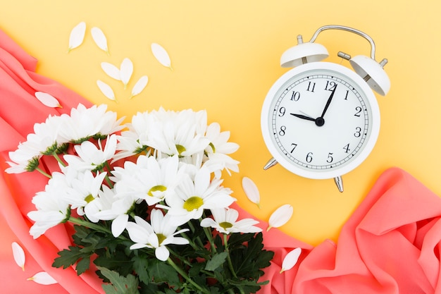 Top view arrangement with bouquet and clock