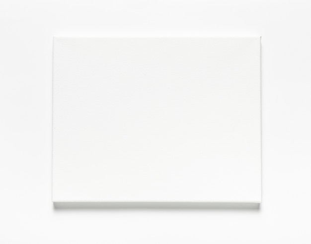 Top view arrangement with canvas on white background