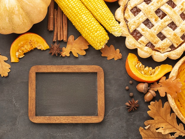 Top view arrangement with corn and wooden background