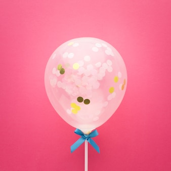Top view arrangement with cute balloon and ribbon