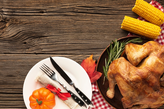 Top view arrangement with delicious meal on wooden background