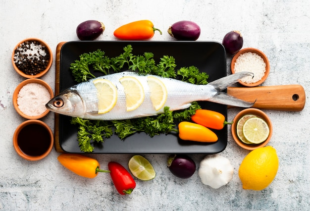 Top view arrangement with fish and vegetables