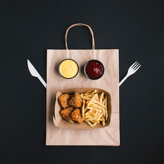 Top view arrangement with food on paper bag