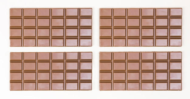 Top view arrangement with four chocolate bars