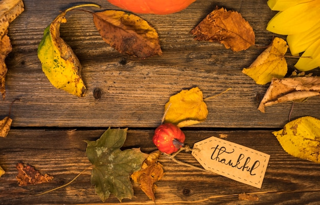 Top view arrangement with leaves on wooden background