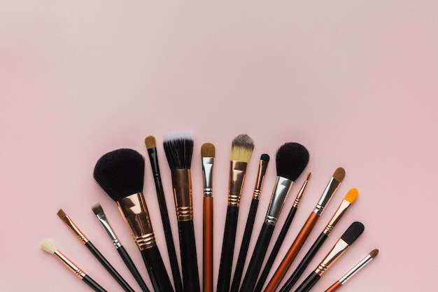 Top view arrangement with make-up brushes