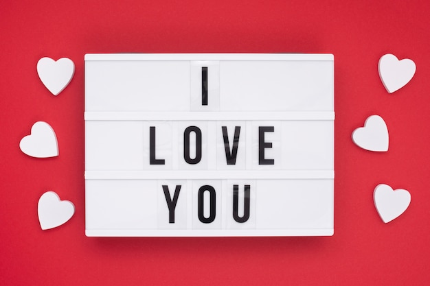 Top view arrangement with message on red background