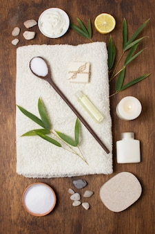 Top view arrangement with plant and spoon on towel