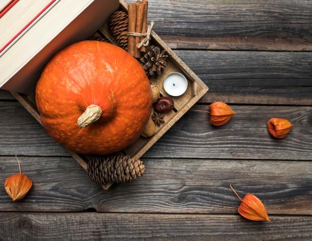 Top view arrangement with pumpkin in wooden box