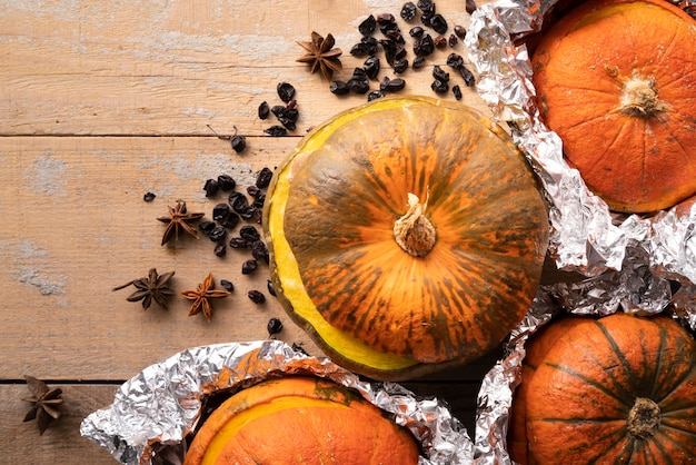 Top view arrangement with pumpkins and wooden background