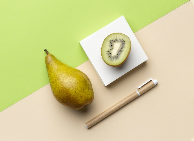 Top view arrangement with stationery elements and fruits