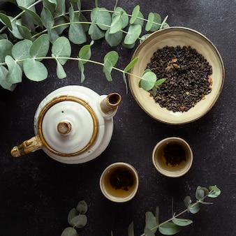 Top view arrangement with tea and herbs
